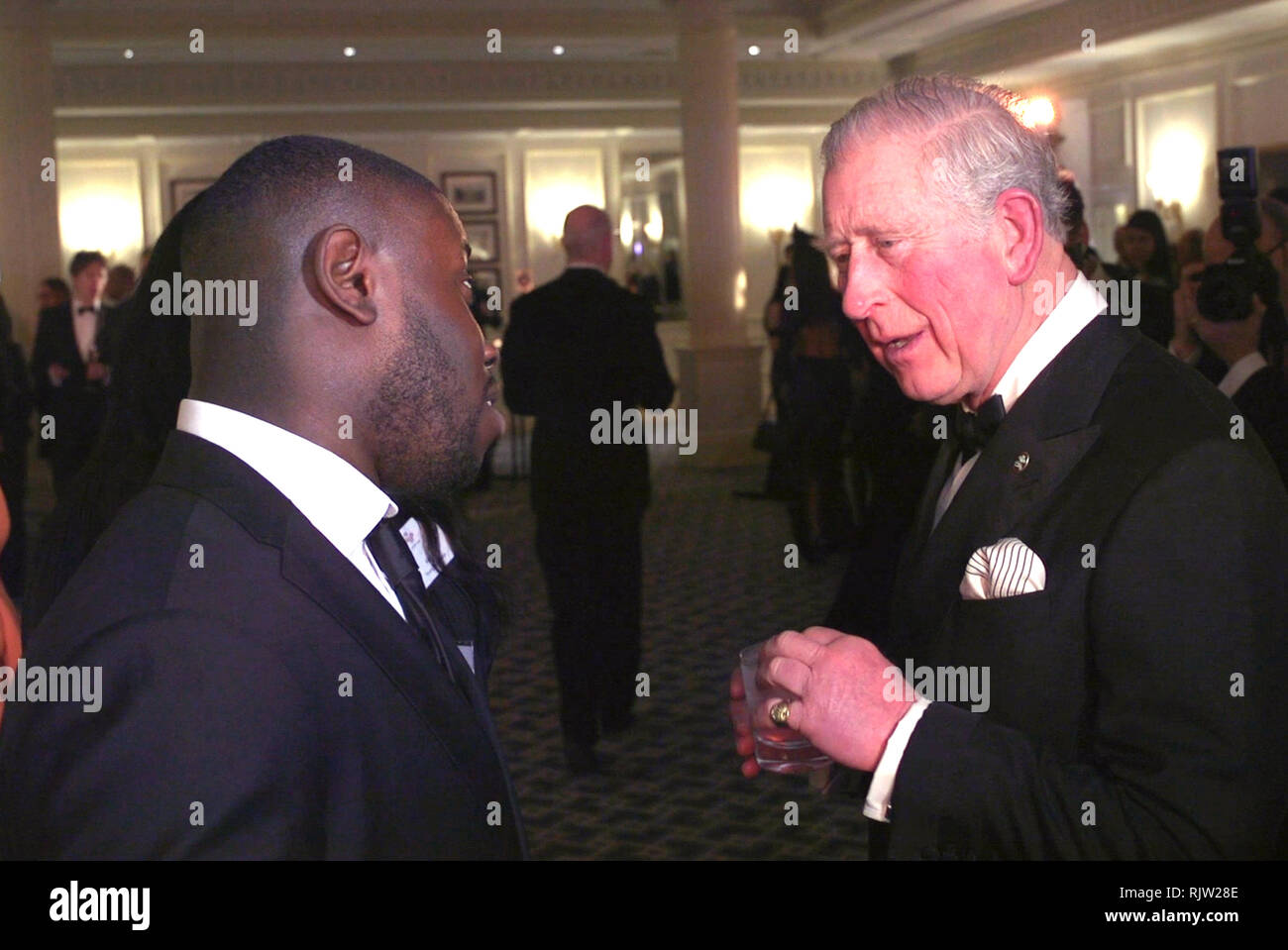 The Prince of Wales speaks to young ambassador Gideon Buabeng during an Invest in Futures Reception at the Savoy in London. - Stock Image