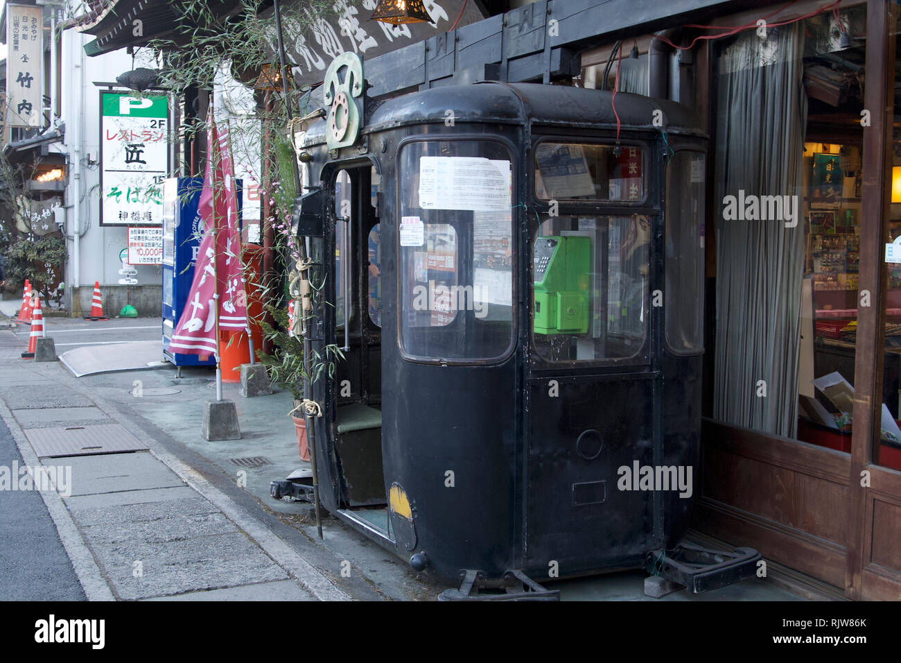 Nikko-Green public telephone in an old black cab on Nihon Romantic Highway - Stock Image