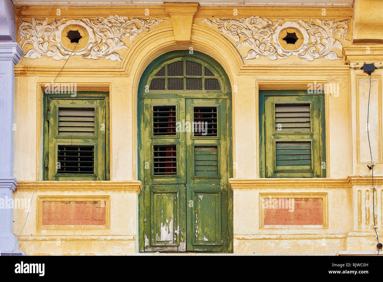 a old shophouse building on the street in George Town, Penang, Malaysia - Stock Image