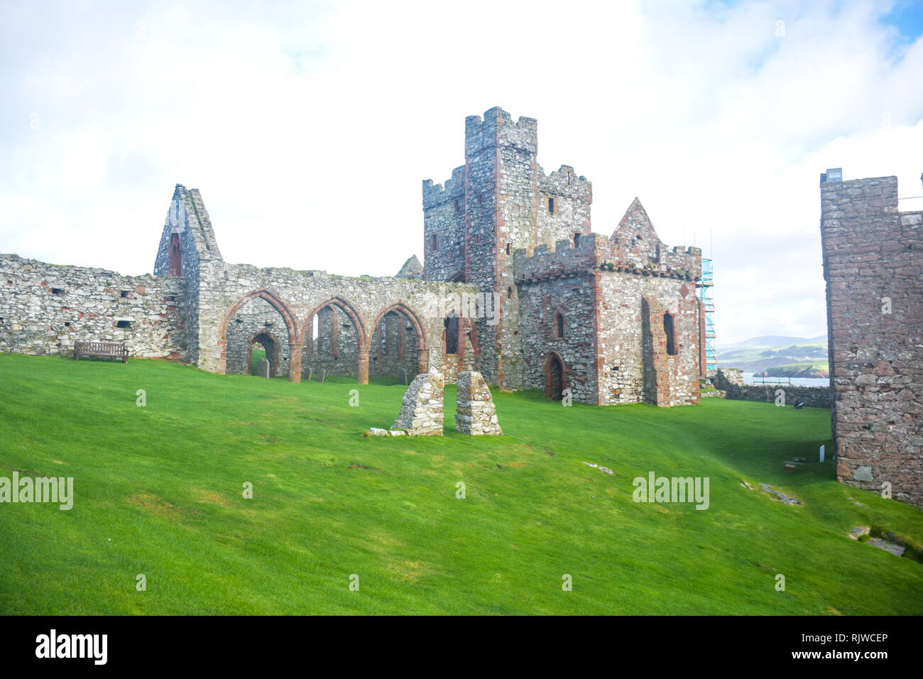 The remains of Peel Castle on St Patrick's Isle constructed by Vikings in Peel city in the Isle of Man - Stock Image