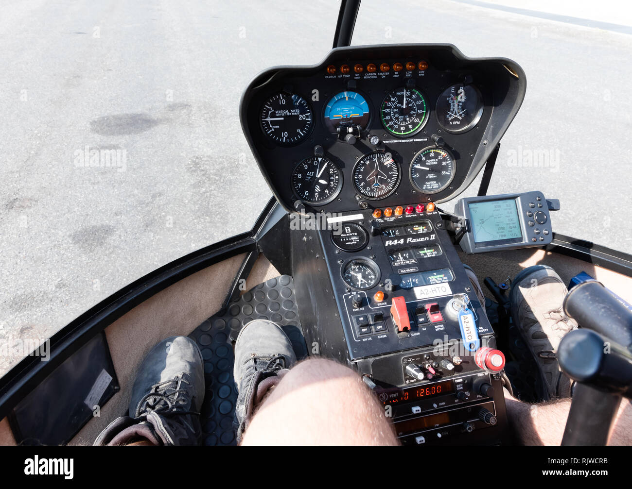 Wide view, a cockpit of a small helicopter, a control panel and a