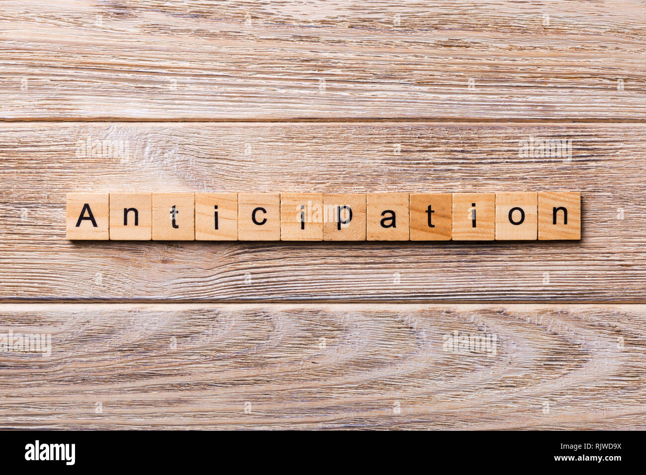 anticipation word written on wood block. anticipation text on wooden table for your desing, concept. - Stock Image