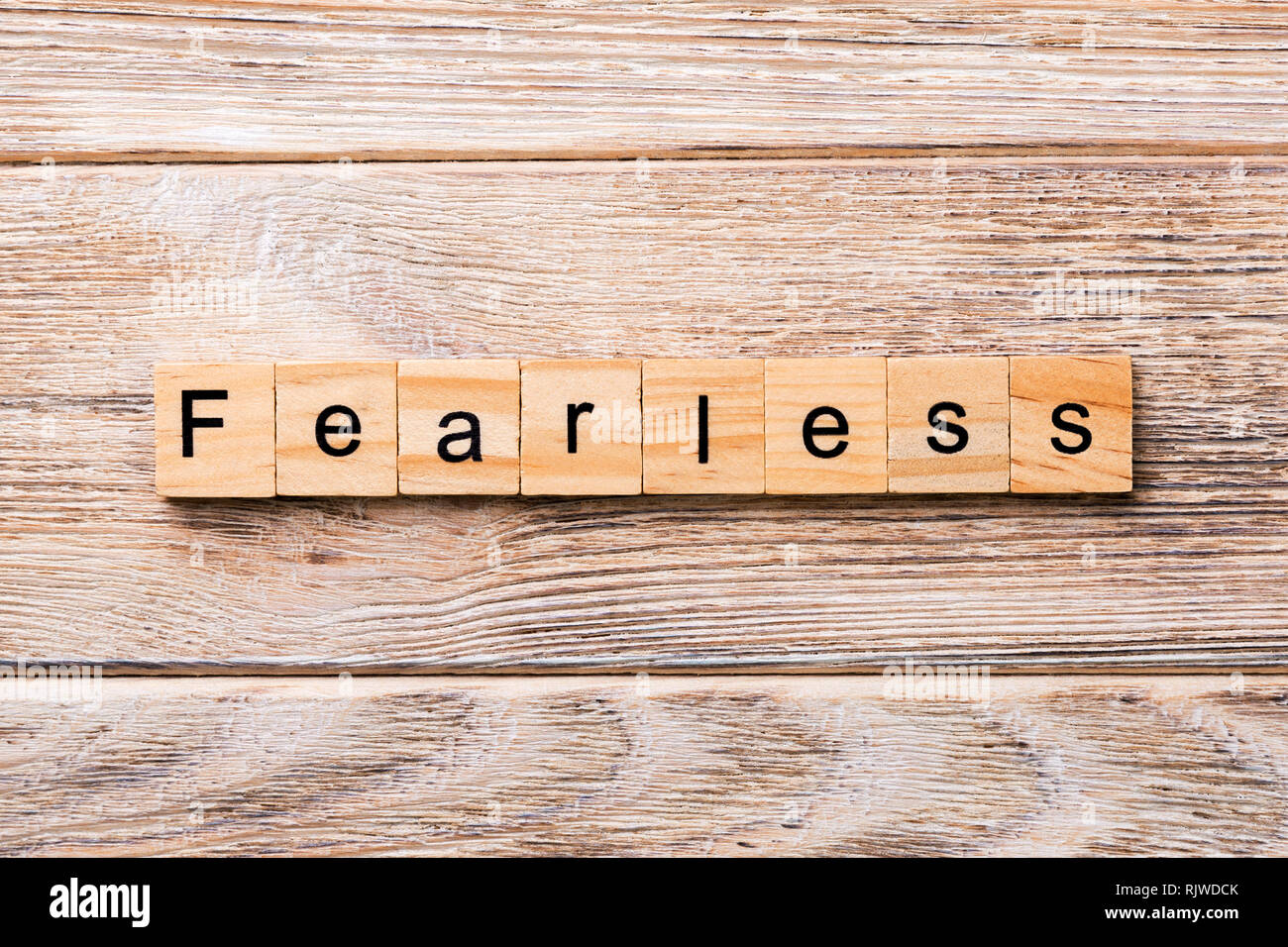 Fearless word written on wood block. Fearless text on wooden table for your desing, concept. - Stock Image