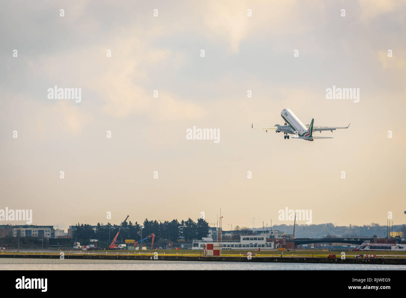 London, England. February 2018. Embraer ERJ-190STD Alitalia Cityliner EI-RNA departing from London City Airport (LCY) - Stock Image