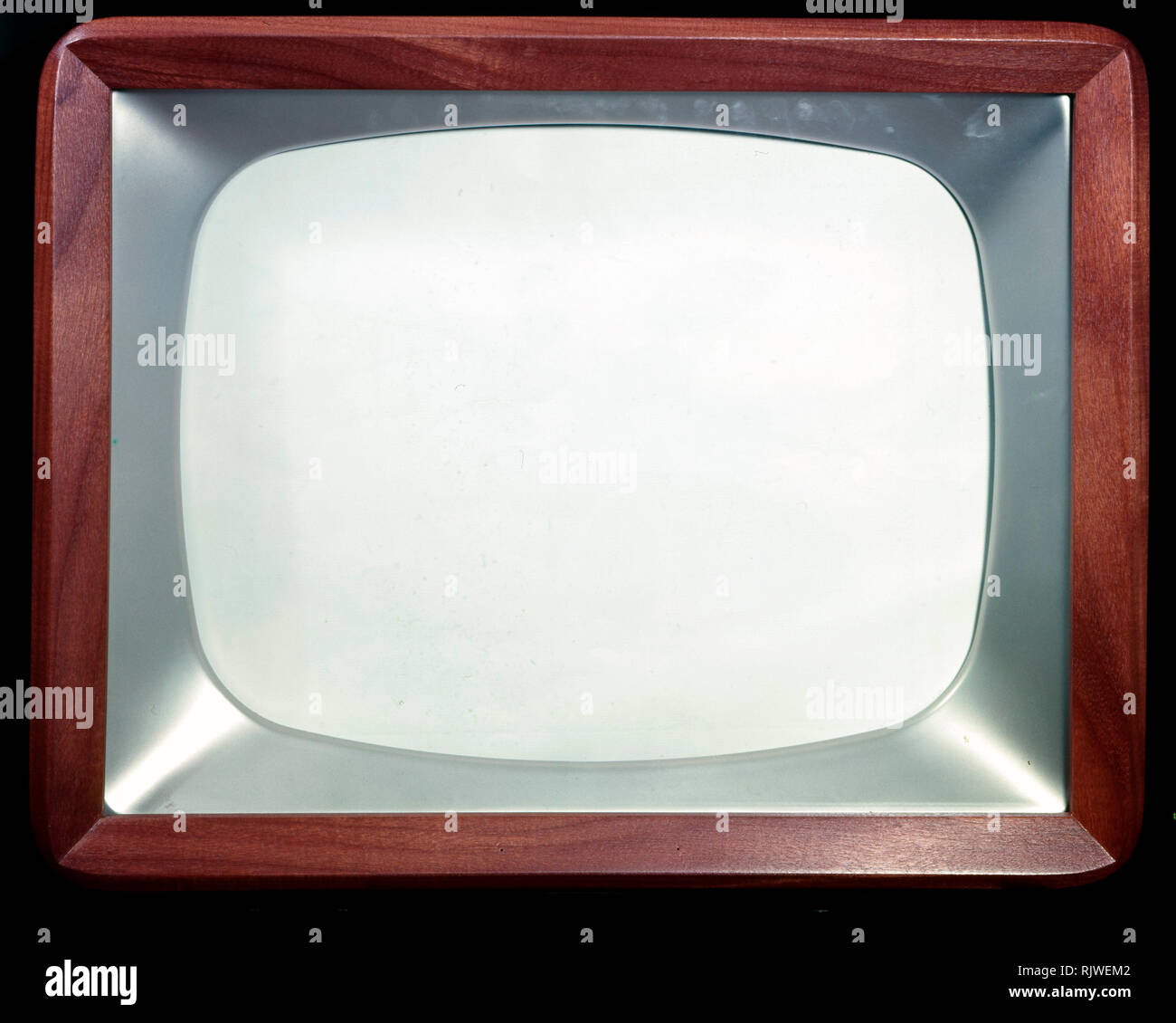 Television in the 1950s. A typical tv furniture in a wooden casing with a small tv-screen. 1958 - Stock Image