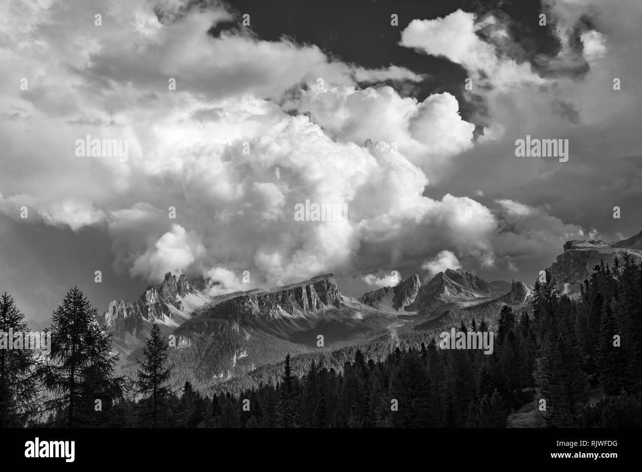 The Dolomites, Northern Italy. The peaks of the 2182m Crepe dei Ronde, Nuvolau (2575m) and Averau (2649m), seen before an advancing thunderstorm (b/w) - Stock Image