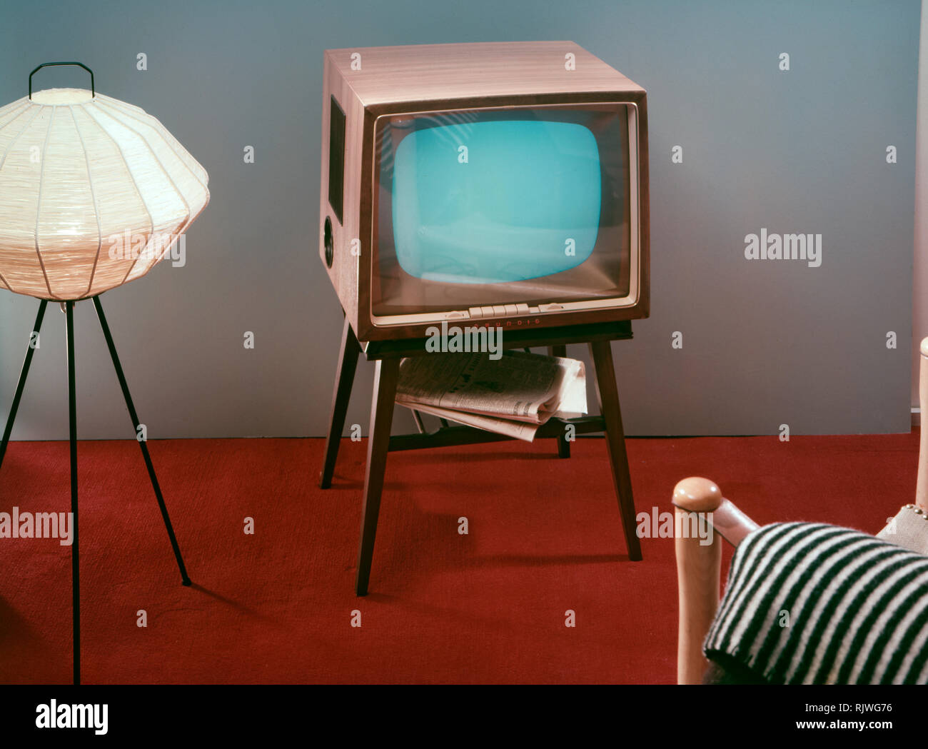 Television in the 1950s. A Grundig television set that was available for customers 1957. A typical 1950s design with a wooden case standing on thin legs. ref BV65-3 - Stock Image