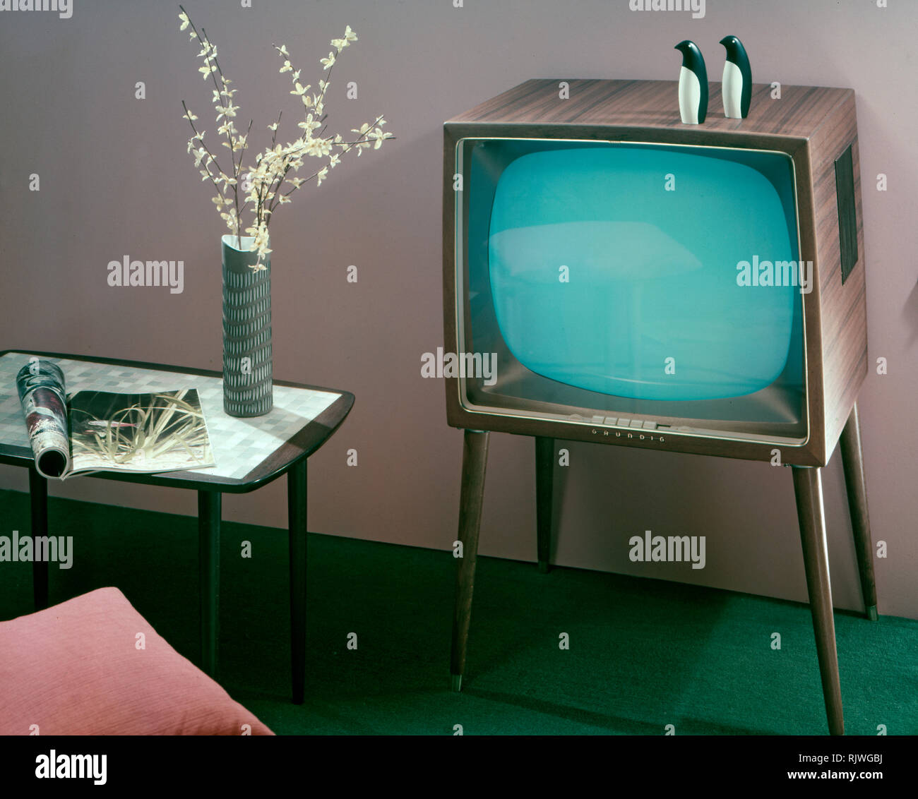 Television in the 1950s. A Grundig television set that was available for customers 1957. A typical 1950s design with a wooden case standing on thin legs. ref BV66-2 - Stock Image