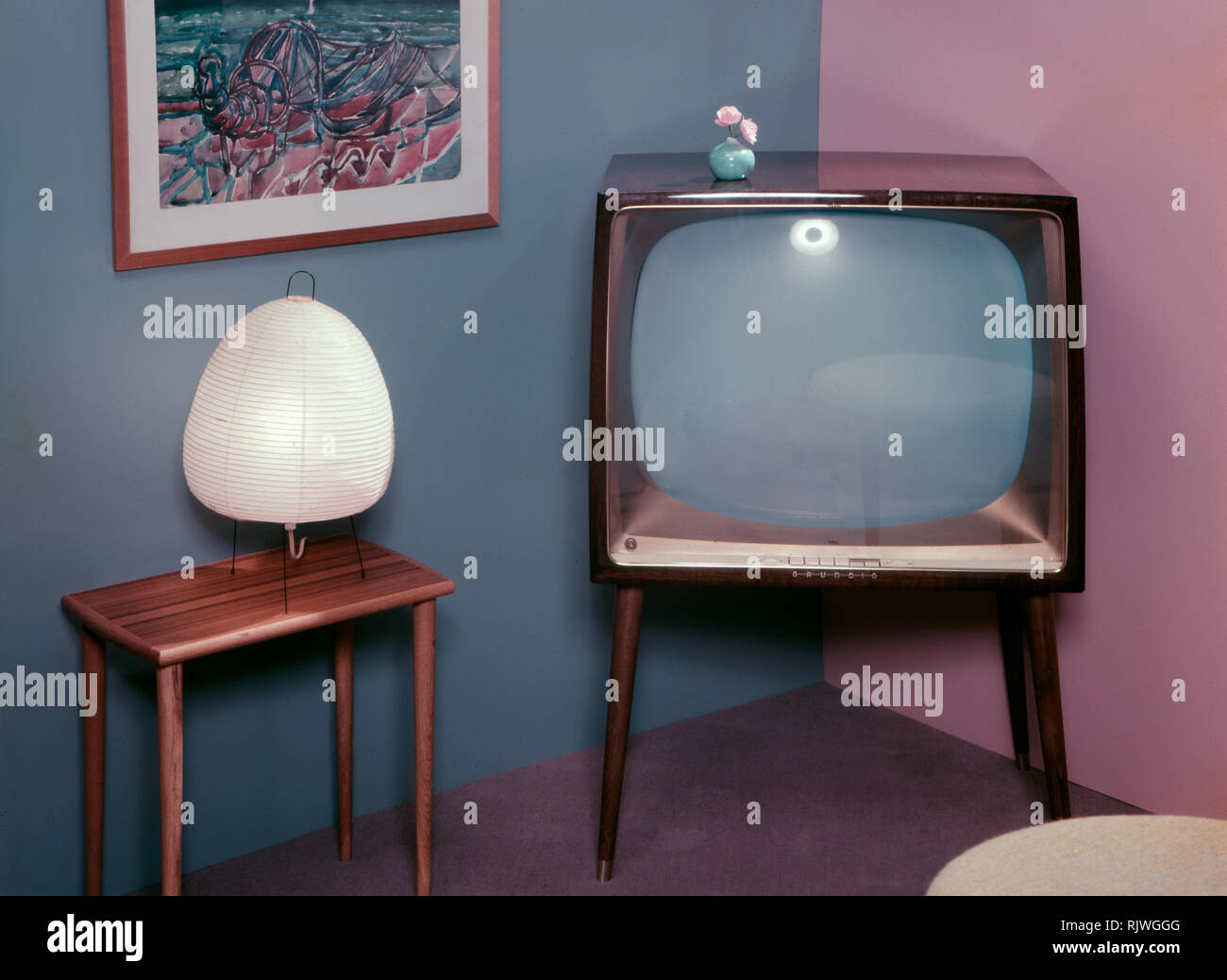 Television in the 1950s. A Grundig television set that was available for customers 1957. A typical 1950s design with a wooden case standing on thin legs. ref BV66-3 - Stock Image
