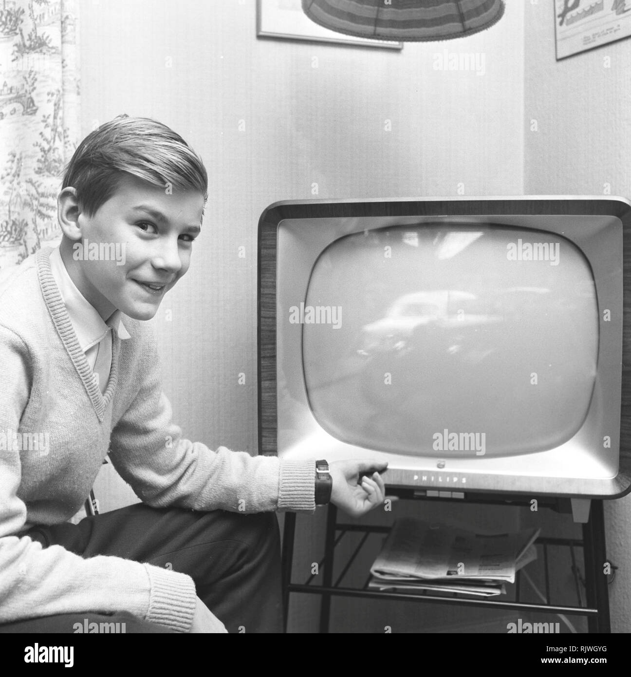 Television in the 1950s. A young man in front of a television set  in January 1959. Sweden - Stock Image