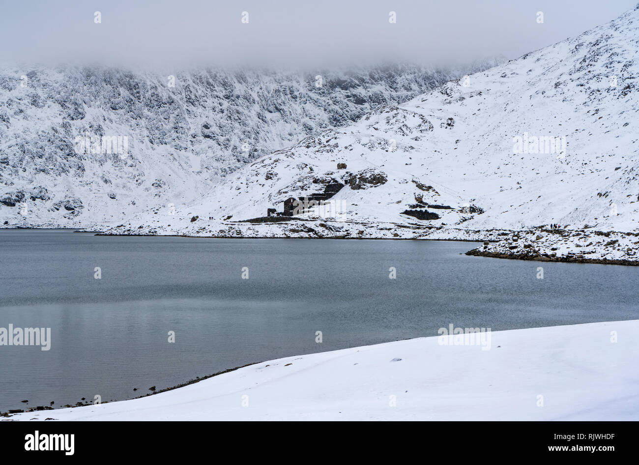 Views along the Miner's Track towards the summit of Y Wyddfa (Snowdon) on a snowy, Winter's day. Stock Photo