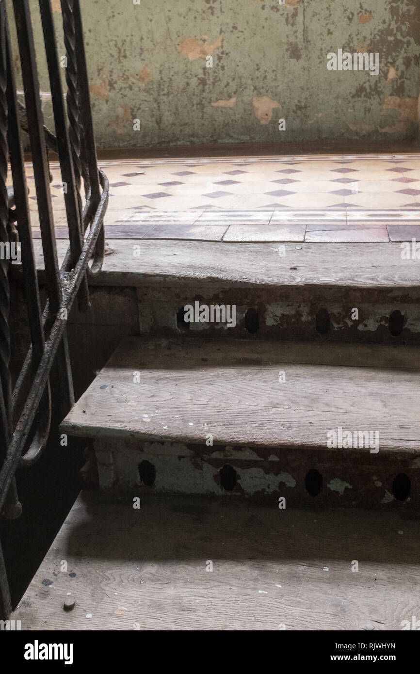 two steps on a wooden staircase ini an old eastern european tenement house Stock Photo
