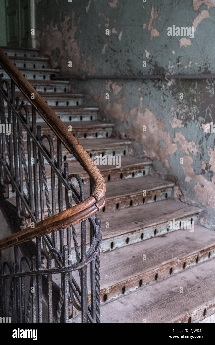 Wooden staircase in a tenement house Stock Photo