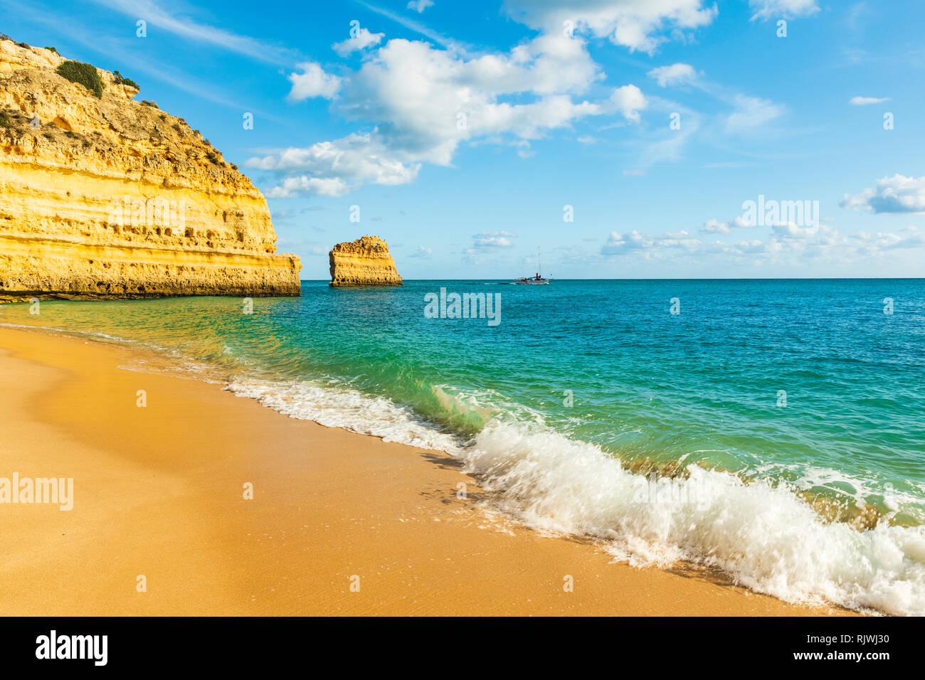 Waves lapping at sandy beach, Praia da Marinha, Algarve, Portugal, Europe - Stock Image