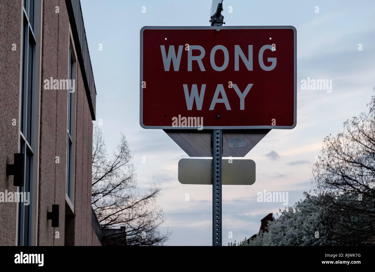 Wrong Way red traffic sign at Downtown McKinney, Texas.  March 2018 - Stock Image