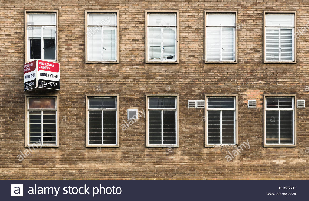 The former central Peterborough Police Station in Bridge Streetis unoccupied with a sign saying under offerin February 2019 - Stock Image