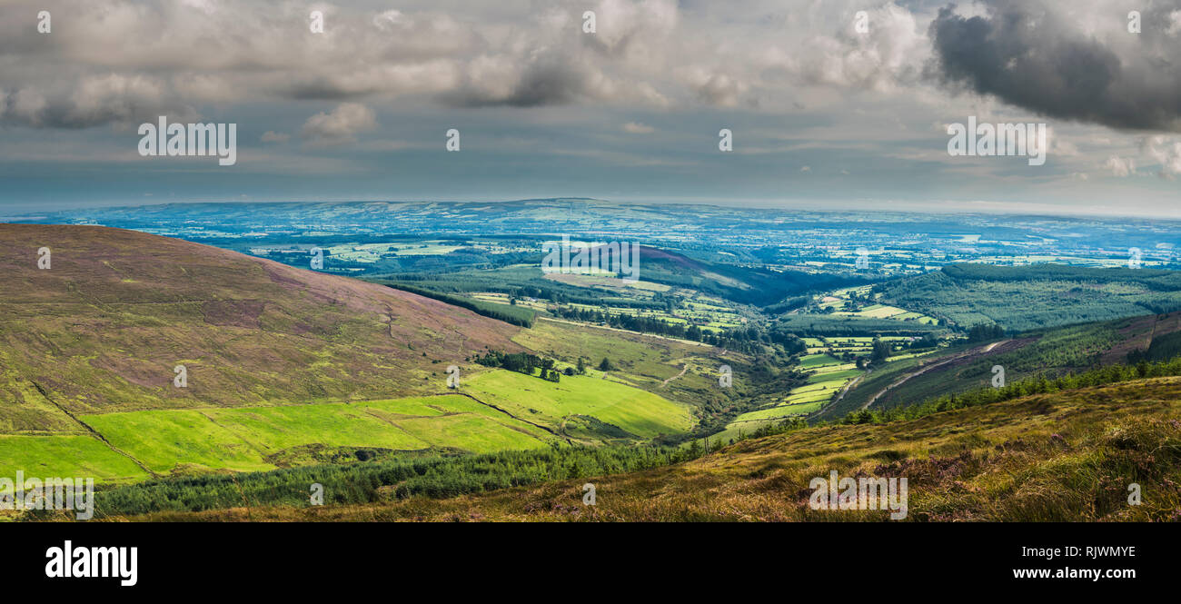 Panoramic view northwards across the Golden Vale of Tipperary towards Slievenamon from Knockmeal, Knockmealdown Mountains, County Waterford, Ireland - Stock Image