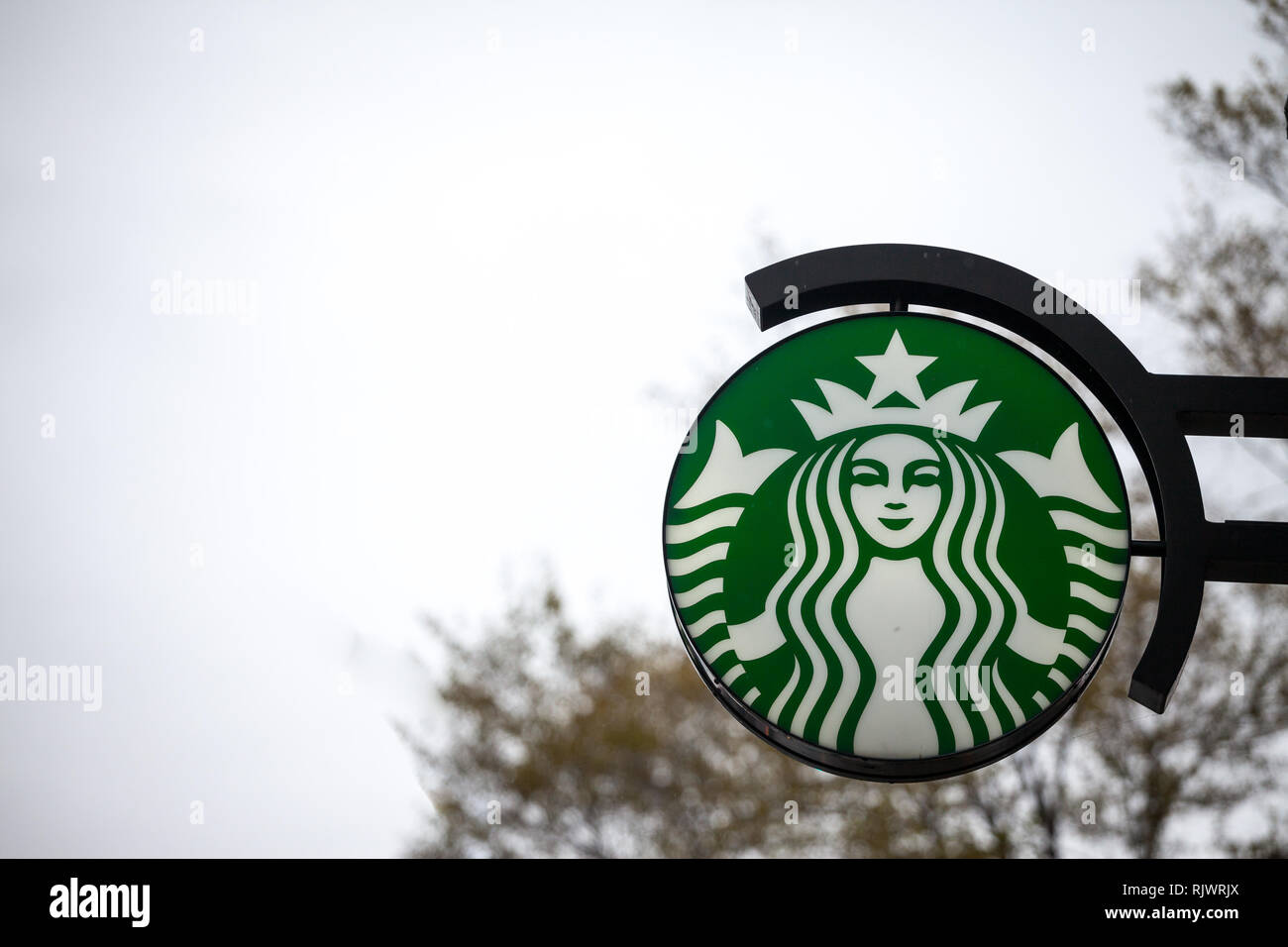 MONTREAL, CANADA - NOVEMBER 6, 2018: Starbucks logo in front of a Starbucks coffeehouse in the city center of Montreal, Quebec. Montreal is a brand of - Stock Image