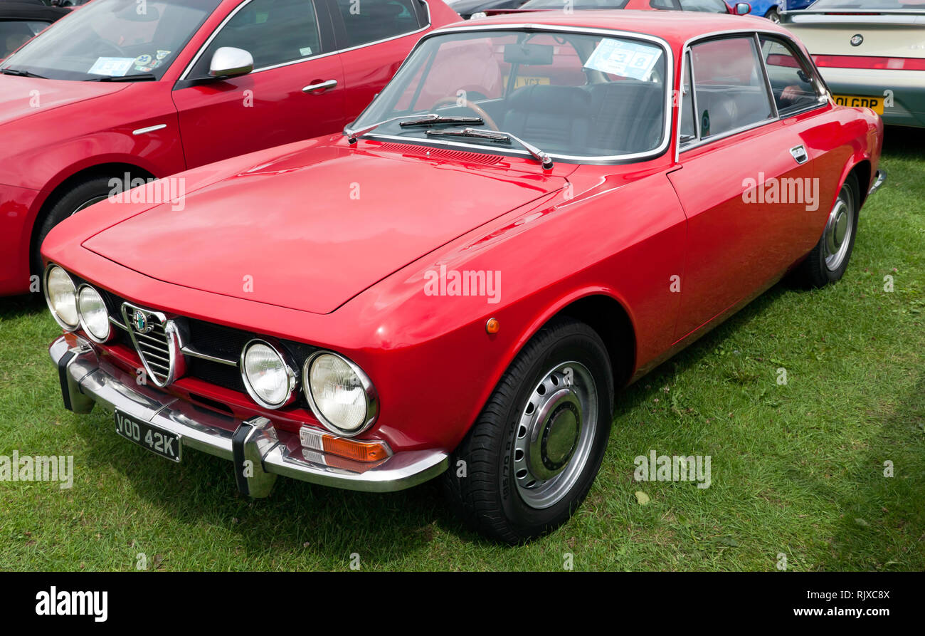 Three-quarter front view of a 1971, Alpha Romeo GTV, on display in he Car Club Zone at the 2017 Silverstone Classic - Stock Image