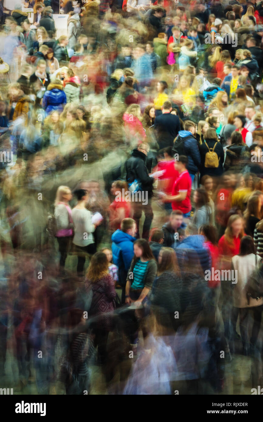 Long exposure photograph of people in an art fair, studies fair, motion blur, moving people, crowd - Stock Image