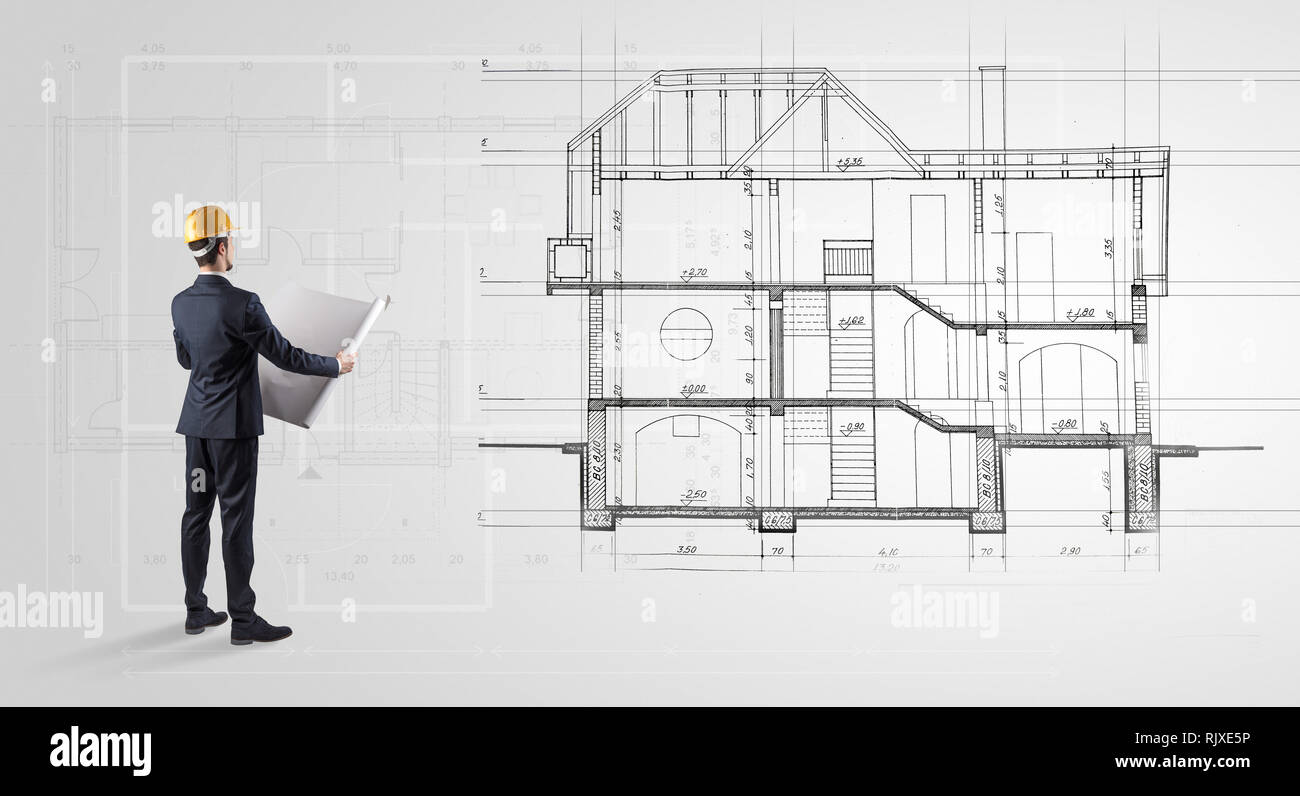 Architect watching a 2 dimension house plan  - Stock Image