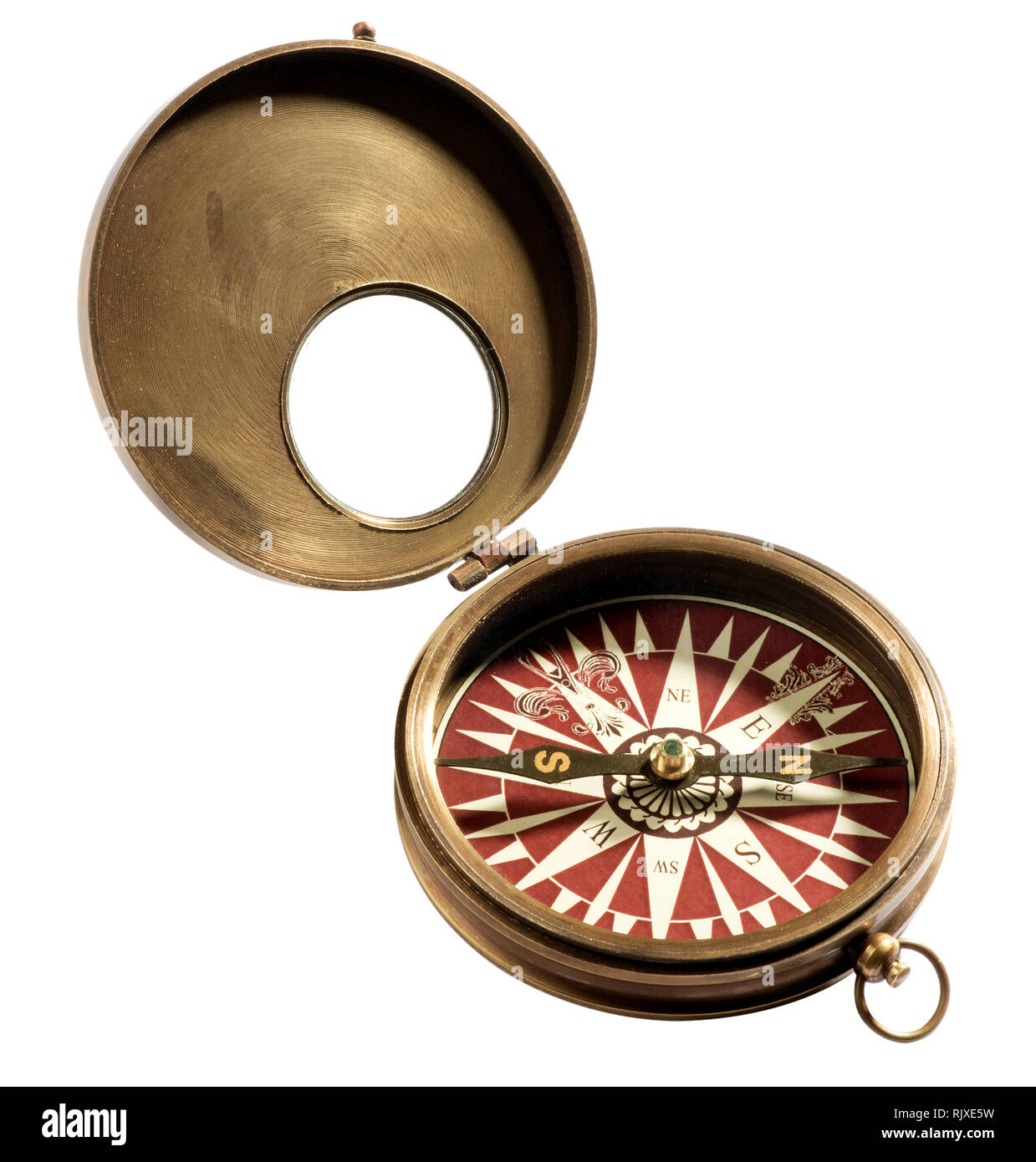 Old vintage compass isolated on white background, viewed in close-up - Stock Image