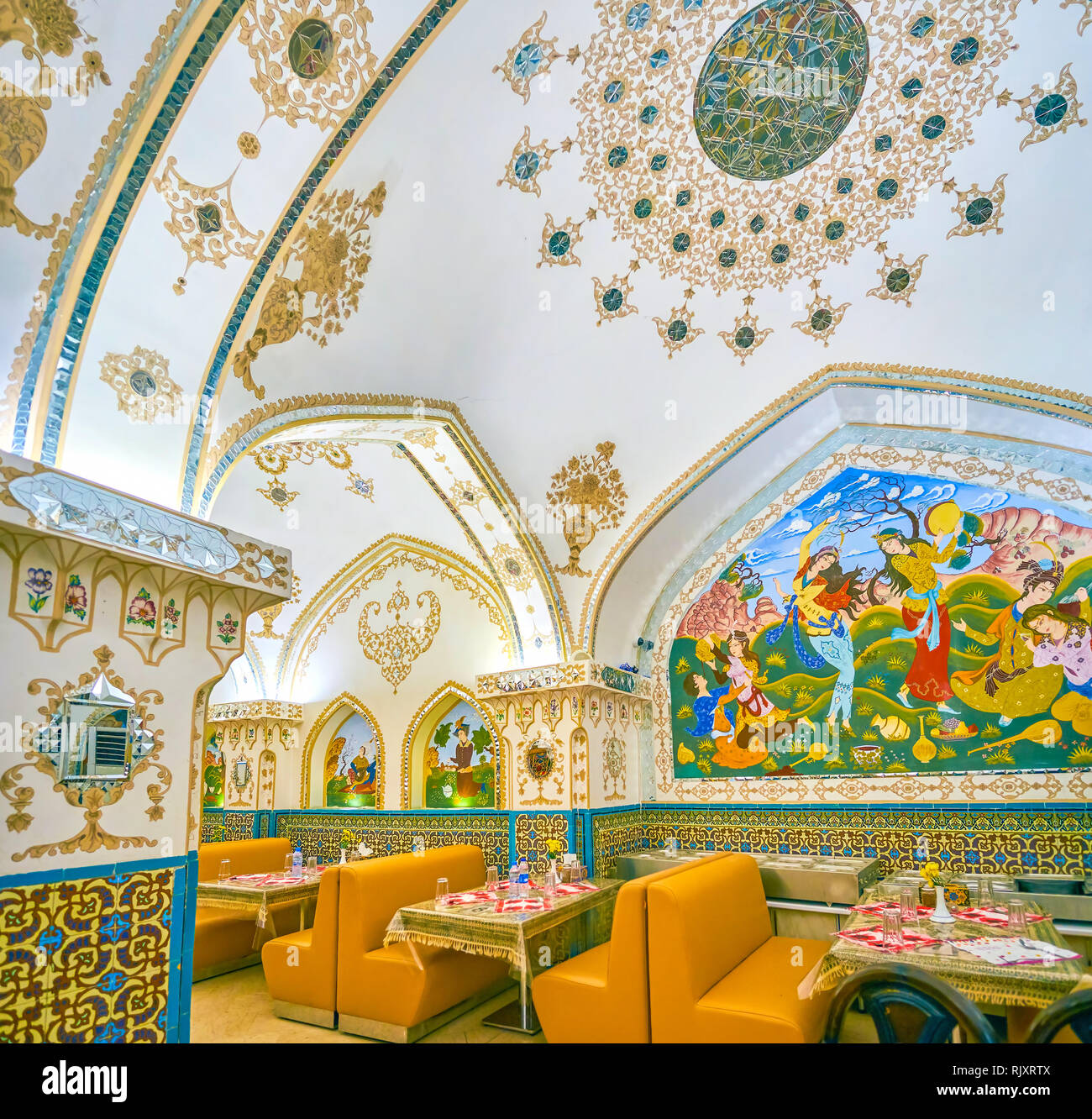 ISFAHAN, IRAN - OCTOBER 19, 2017: The beautifully decorated interior of Baastan restaurant in combination of mirrorwork, painted patterns and pictures Stock Photo