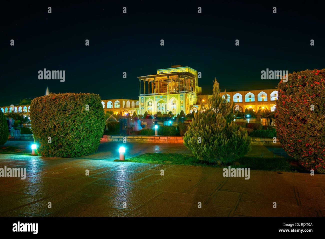 The pleasant evening in Nashq-e Jahad Square with beautifully illuminated Ali Qapu Palace, Isfahan, Iran Stock Photo