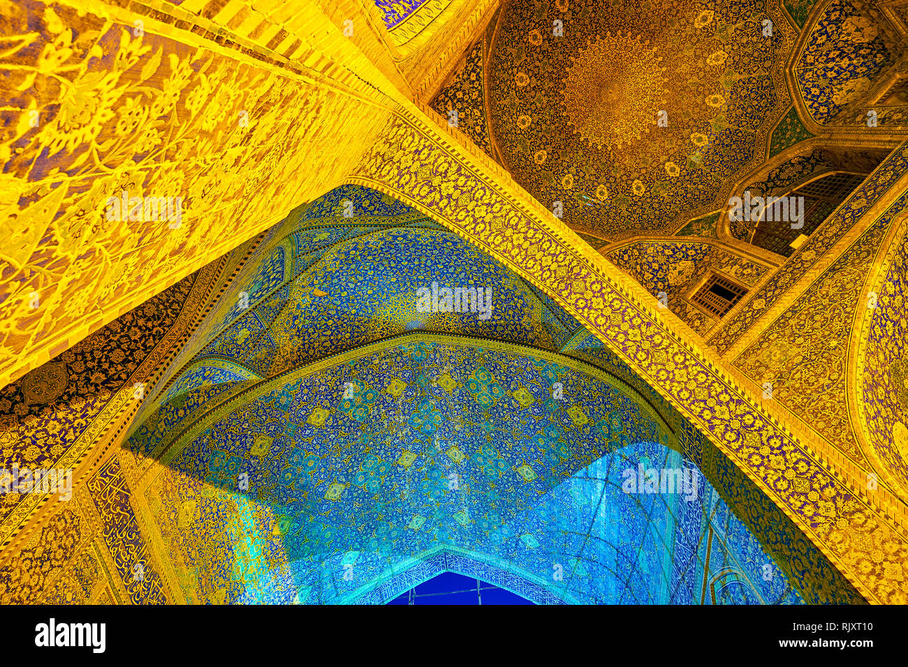 ISFAHAN, IRAN - OCTOBER 19, 2017: The beautiful ceilings and arches of Shah Mosque complex with unique Persian style floral patterns, on October 19 in - Stock Image