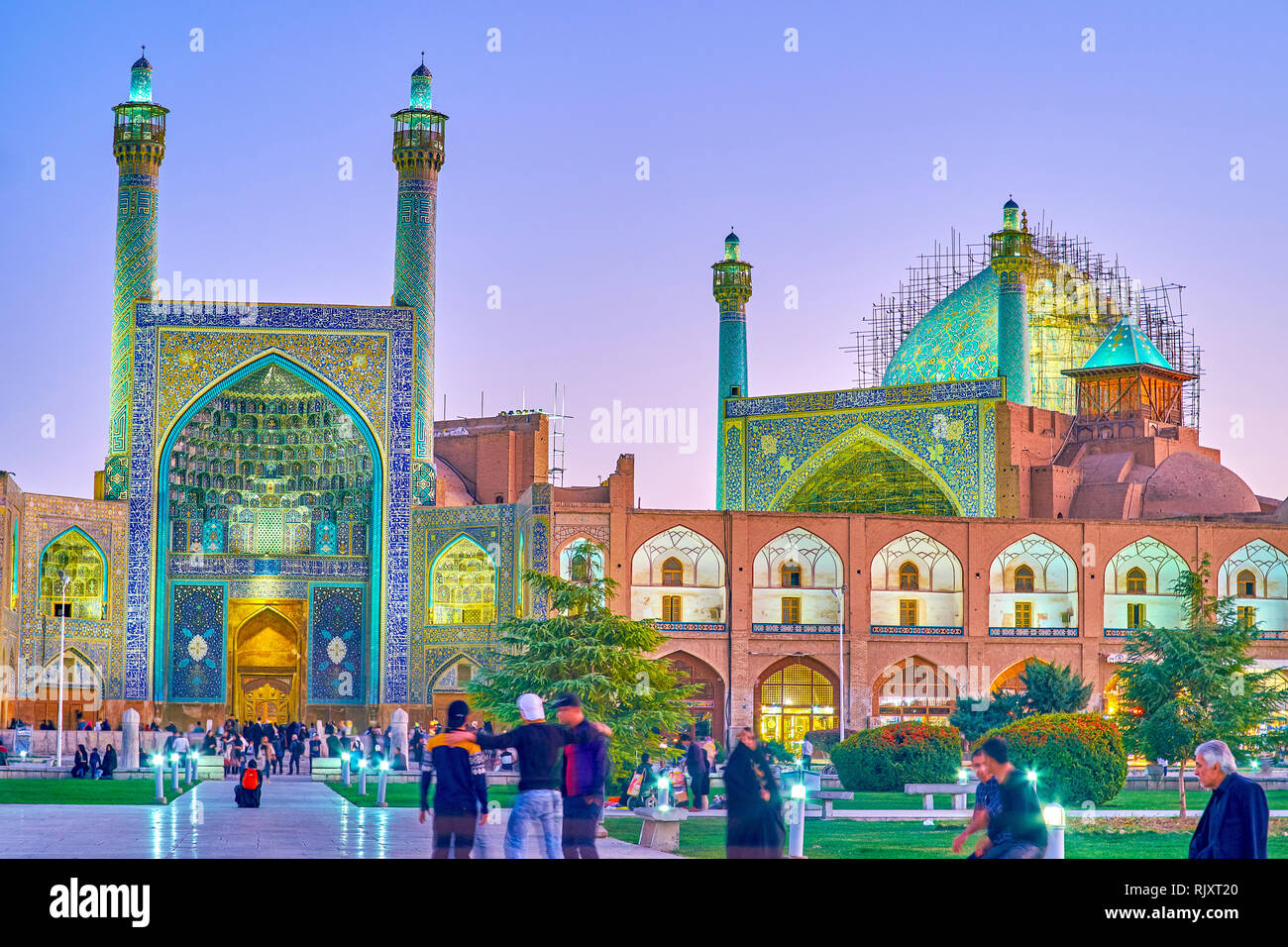 ISFAHAN, IRAN - OCTOBER 19, 2017: The beautiful evening illumination of colorful Shah Mosque, on October 19 in Isfahan Stock Photo