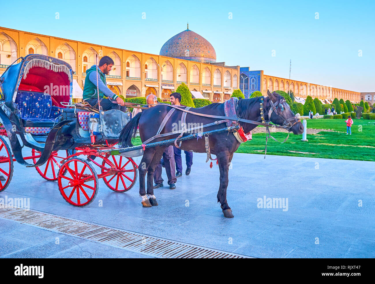ISFAHAN, IRAN - OCTOBER 19, 2017: Nashq-e Jahad Square is the main tourist destination in the city, that offer variety of interesting attractions, suc Stock Photo