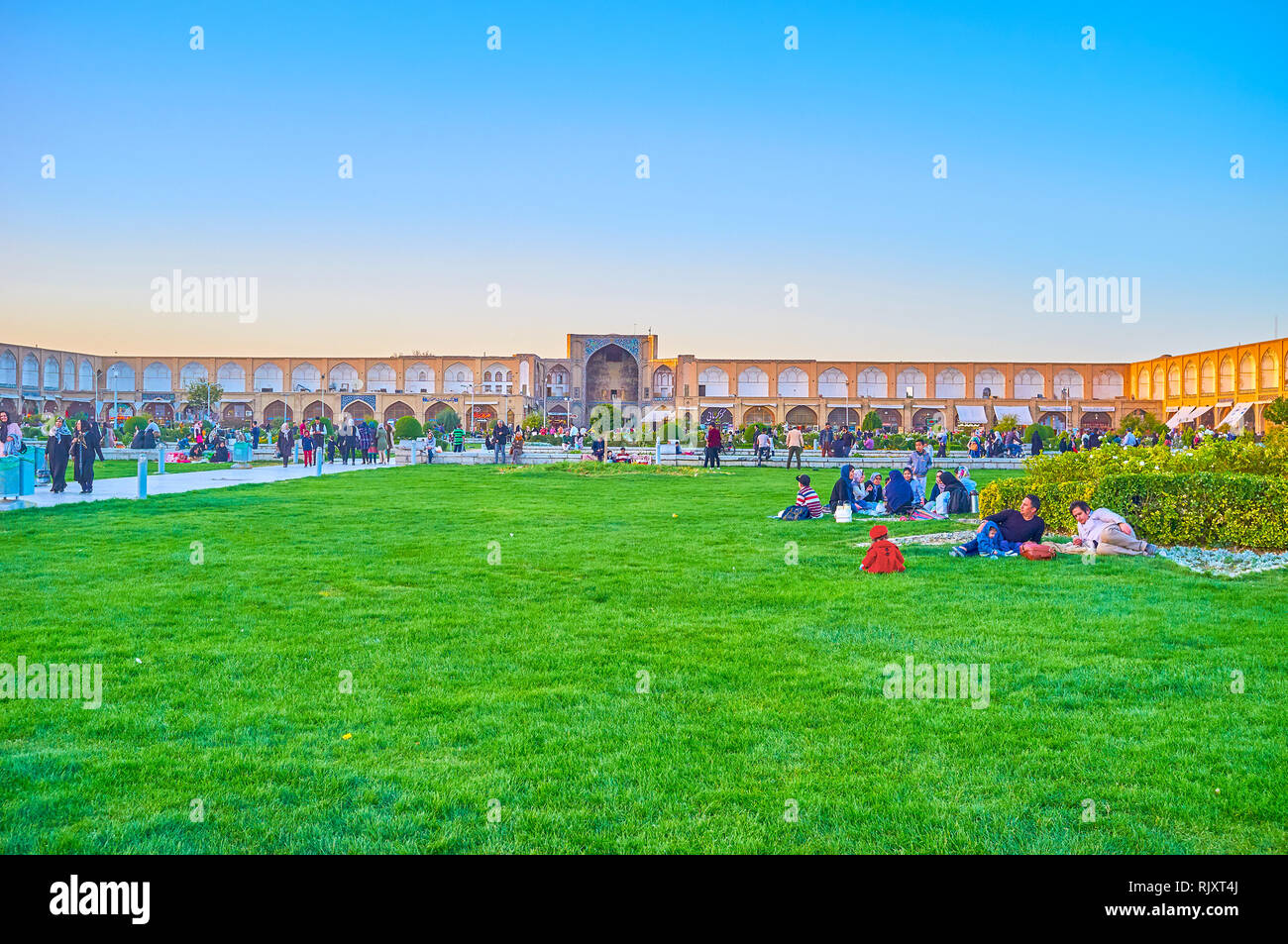 ISFAHAN, IRAN - OCTOBER 19, 2017: Weekend picnics are very popular events in life of Iranian families, and park in Naqsh-e Jahan Square is one of the  - Stock Image