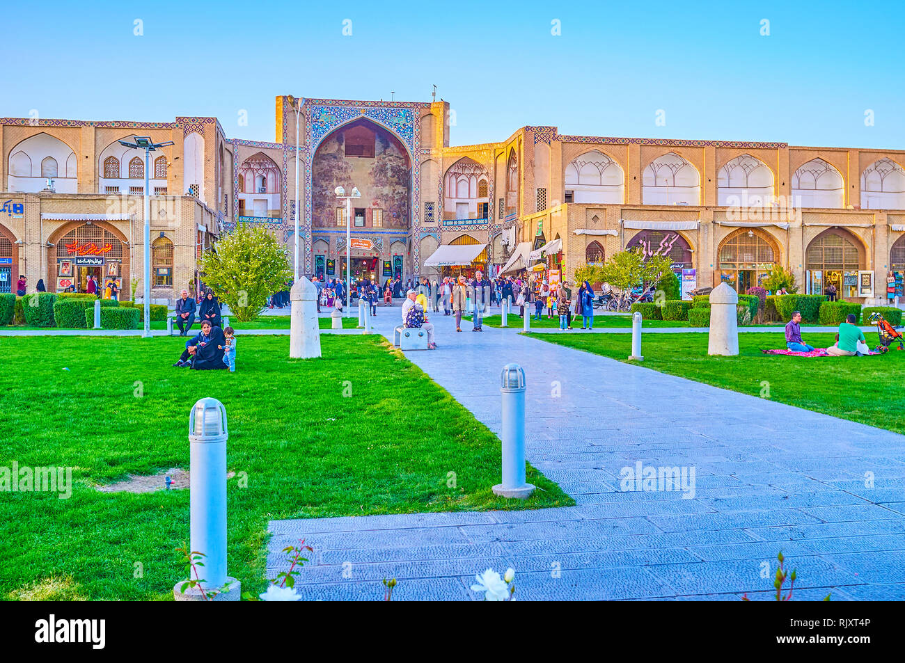 ISFAHAN, IRAN - OCTOBER 19, 2017: The old Qeysarie Gates with partly preserved decorations located in Naqsh-e Jahan Square, on October 19 in Isfahan Stock Photo