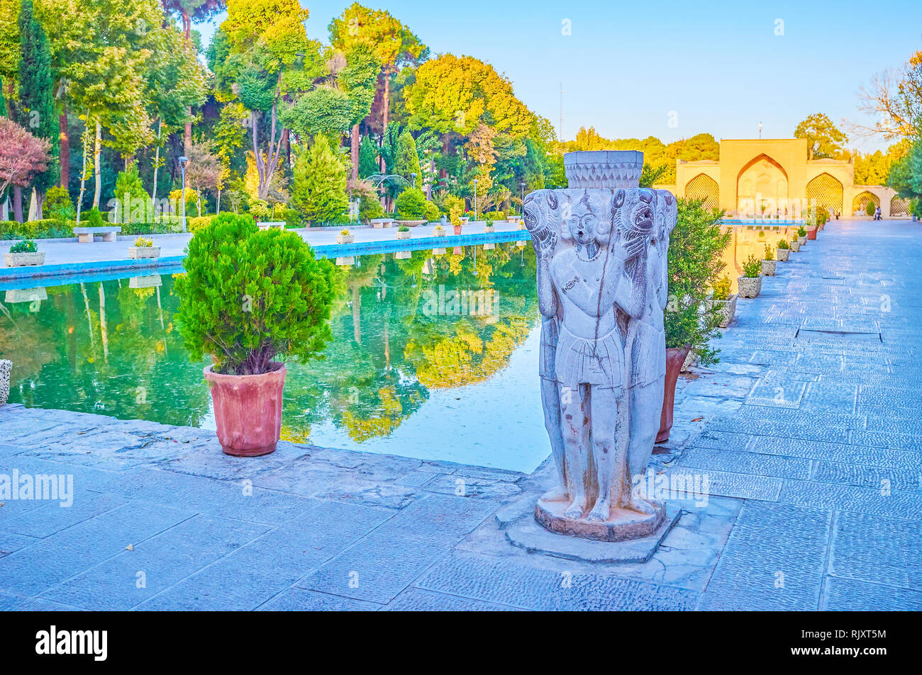 The beautiful stone sculpture in Persian style located at the edges of the main pool in Chehel Sotoun Palace complex, Isfahan, Iran - Stock Image