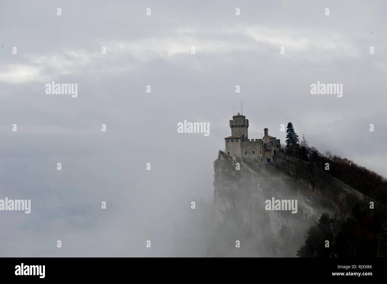 Europe, italy, Marche, The Guaita fortress (Prima Torre) is the oldest and the most famous tower, Monte Titano, San Marino. It was built in the 11th - Stock Image
