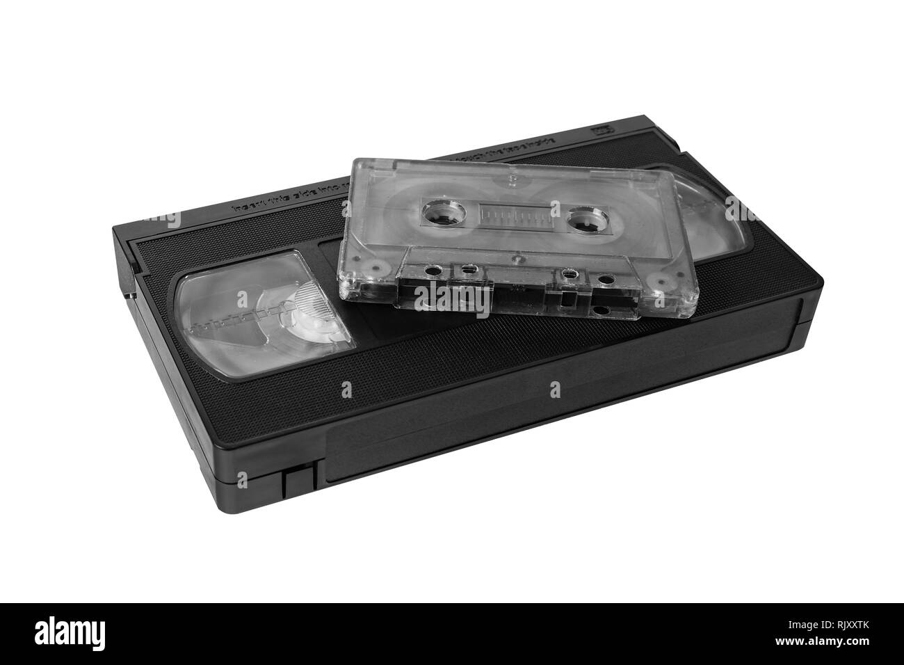 audio tape cassette and VHS video tape cassette on white background, isolated - Stock Image