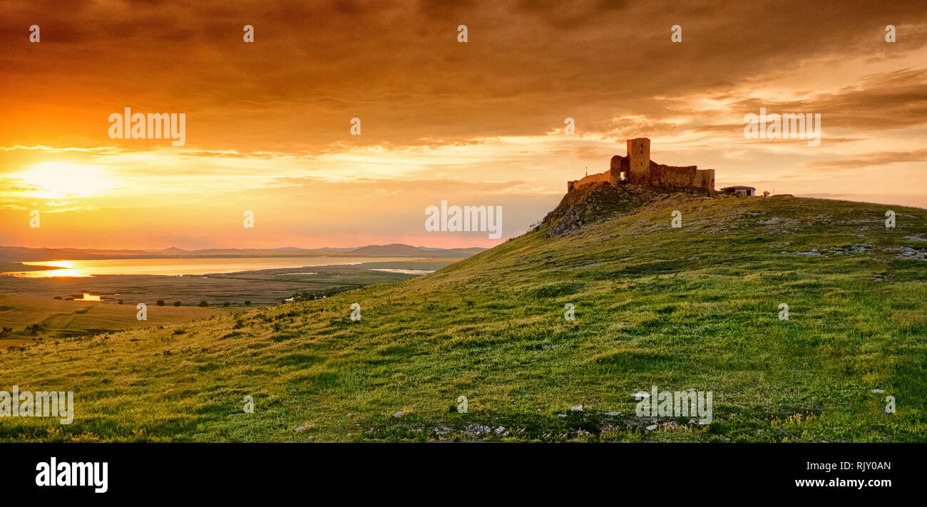 Romania sunset in Dobrogea at the Enisala Fortress. Important historical landmark near Tulcea and Constanta - Stock Image