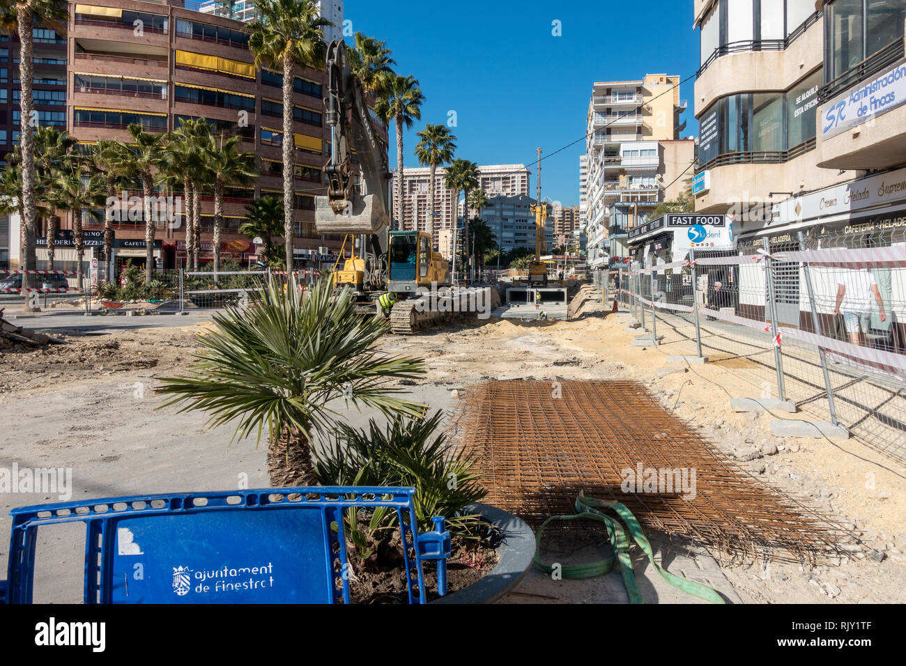 Local council and engineers in La Cala, Alicante province, Spain instal culverts to channel flood waters under the streets during flash floods Stock Photo