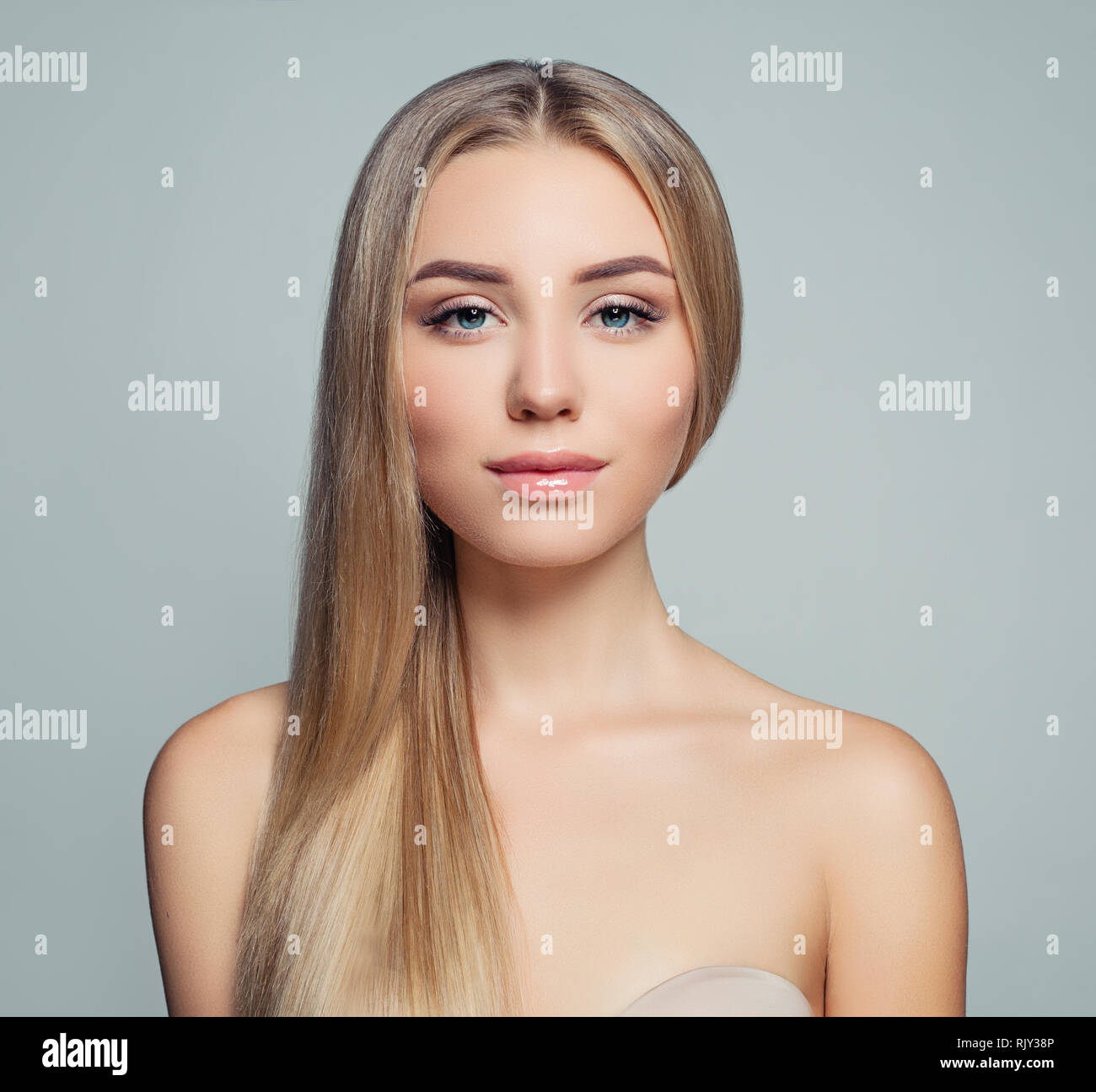Cute Girl With Long Straight Blonde Hair And Healthy Skin Beautiful Female Face Facial Treatment Haircare Facial Lifting And Cosmetology Concept Stock Photo Alamy