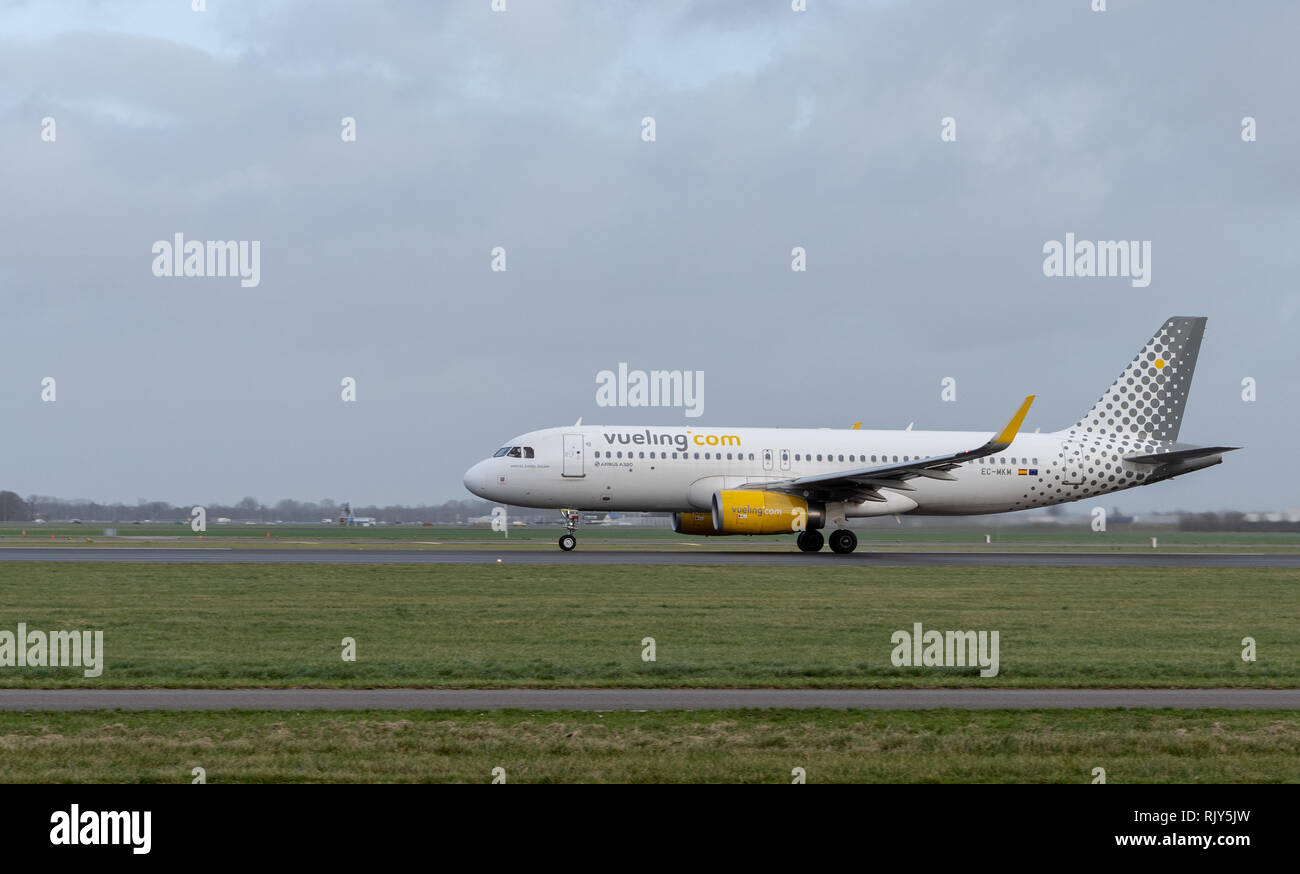 AMSTERDAM / NETHERLANDS - JAN 08, 2019: Vueling Airbus A320-232 EC-MKM passenger plane taking off from Amsterdam Schiphol Airport - Stock Image