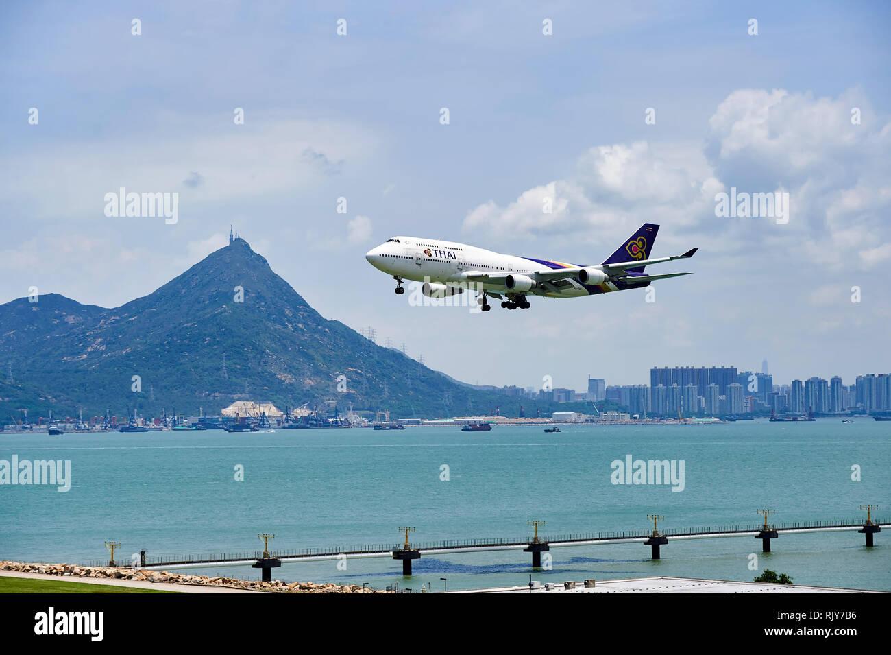 HONG KONG - JUNE 04, 2015: THAI aircraft landing at Hong Kong