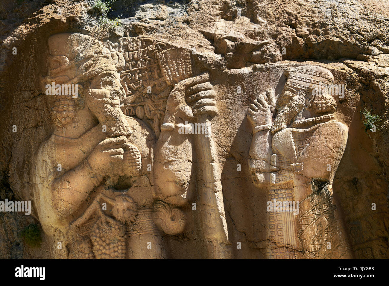 Picture of the Ivriz Hittite rock relief sculpture monument  dedicated to King Warpalawas in which he talks to Tarhundas the God of Thunder. The king  - Stock Image