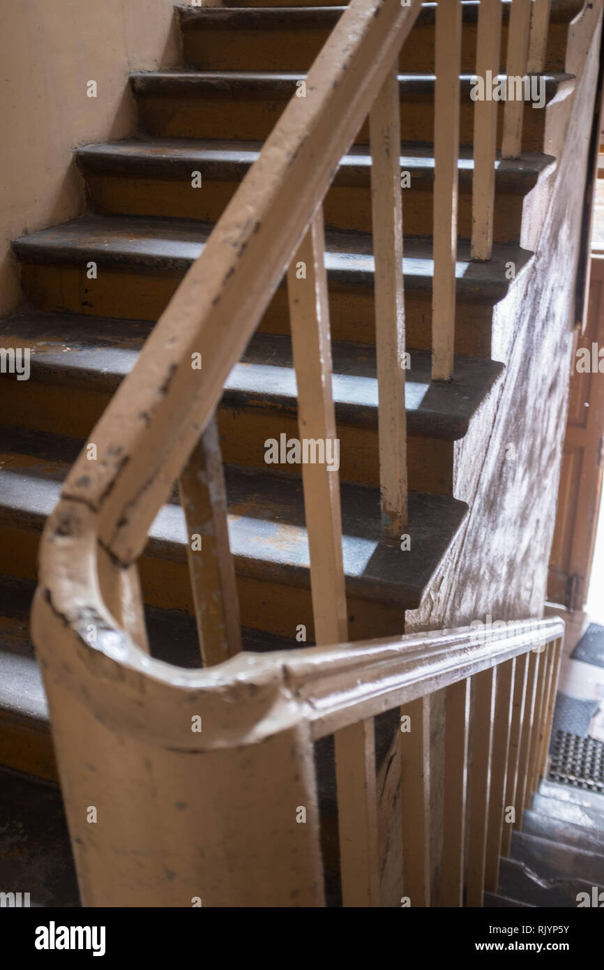 curve of a bannister on a staircase in a tenement house in Warsaw Stock Photo