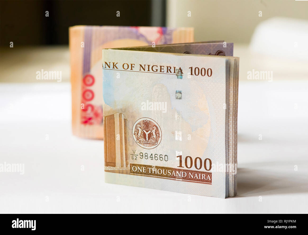 Nigerian Money - A folded wad of 1000 and 500 Naira notes mixed together - Stock Image