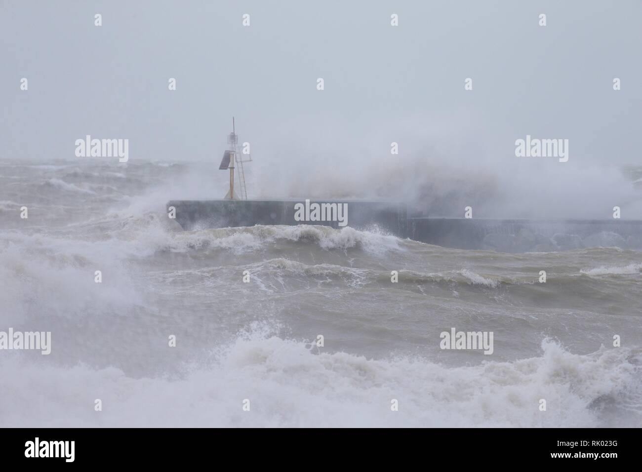 Hastings, East Sussex, UK. 08 Feb, 2019. UK Weather: Storm Erik. Gale force winds bring raging seas to Hastings in East Sussex. The harbour arm takes a battering from the waves. © Paul Lawrenson 2019, Photo Credit: Paul Lawrenson / Alamy Live News Stock Photo