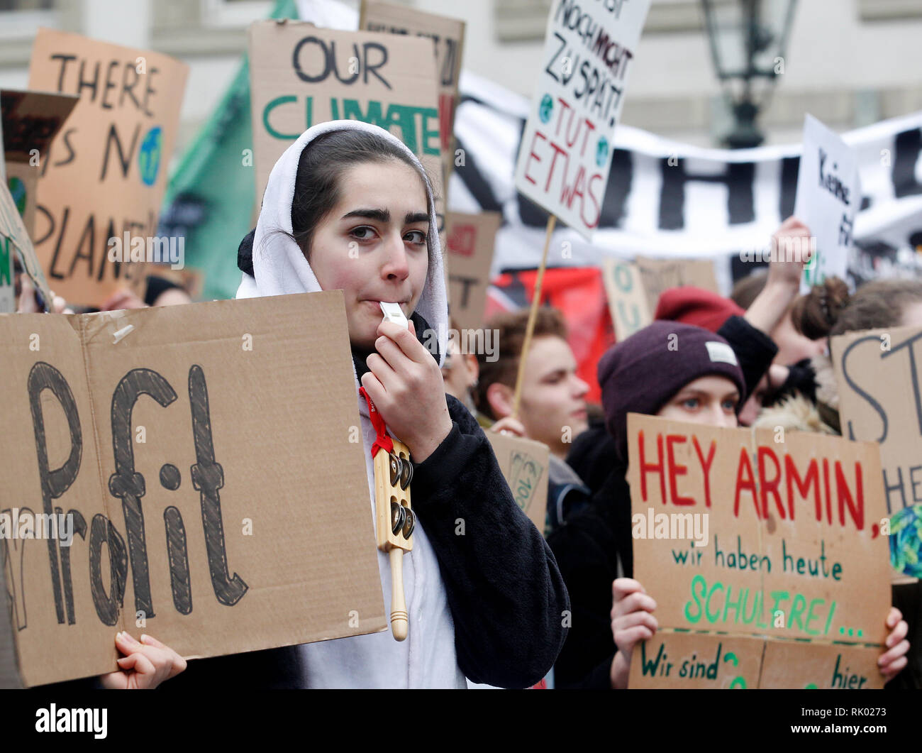 Düsseldorf, Germany. 8th Feb 2019. Students protest loudly during a student demonstration in front of the town hall, also with whistles. The motto of the protest is 'Fridays for Future'. Photo: Roland Weihrauch/dpa Credit: dpa picture alliance/Alamy Live News - Stock Image