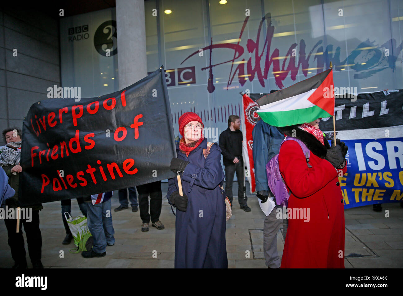 Salford, Greater Manchester, UK. 8th Feb 2019. Pro Palestinian campaigners gather outside the BBC as an audience gathers for the live filming of 'Eurovision you decide'.  Eurovision 2019 will take place in Israel and pro Israeli's also gathered outside the studios  to counter protest  those in support of Palestine who are calling on the BBC to withdraw from the 2019 Eurovision song contest.   BBC, Media City, Salford, UK, 8th February 2019 Credit: Barbara Cook/Alamy Live News - Stock Image