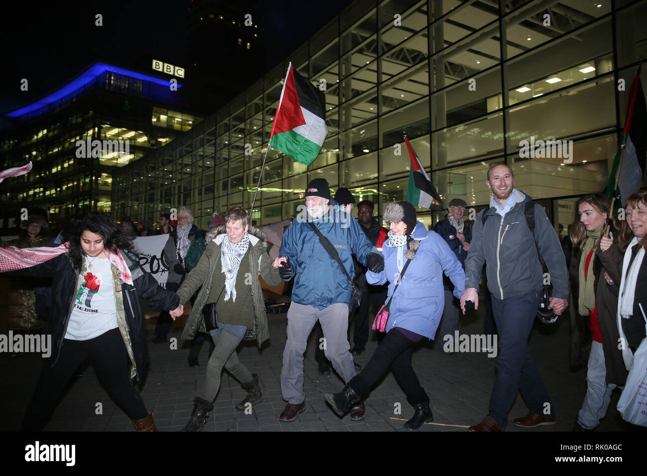 Salford, Greater Manchester, UK. 8th Feb 2019. Pro Palestinian campaigners dancing outside the BBC as an audience gathers for the live filming of 'Eurovision you decide'.  Eurovision 2019 will take place in Israel and pro Israeli's also gathered outside the studios  to counter protest  those in support of Palestine who are calling on the BBC to withdraw from the 2019 Eurovision song contest.   BBC, Media City, Salford, UK, 8th February 2019 Credit: Barbara Cook/Alamy Live News - Stock Image