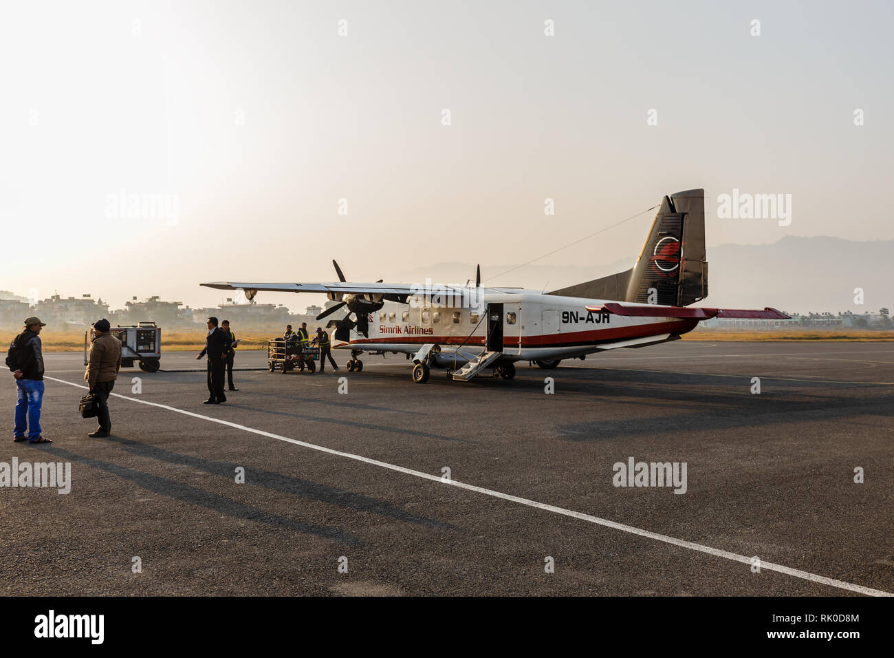 Pokhara, Nepal - November 24, 2016: Small passenger airplane at the Pokhara airport early in the morning preparing to fly. - Stock Image