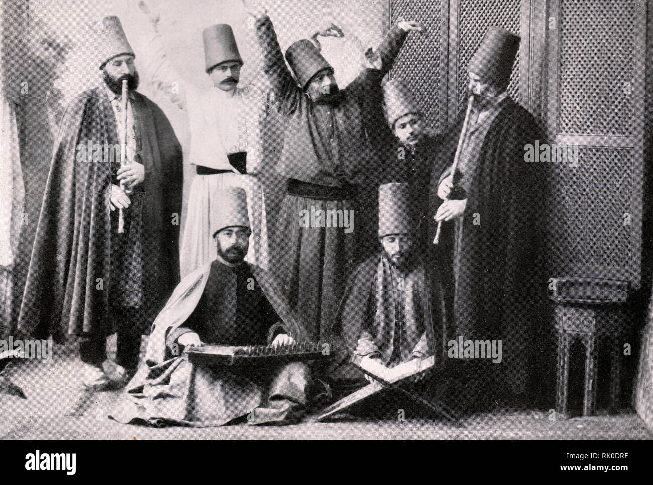 Group of dervishes. Photo. Beginning of the 20th century. - Stock Image